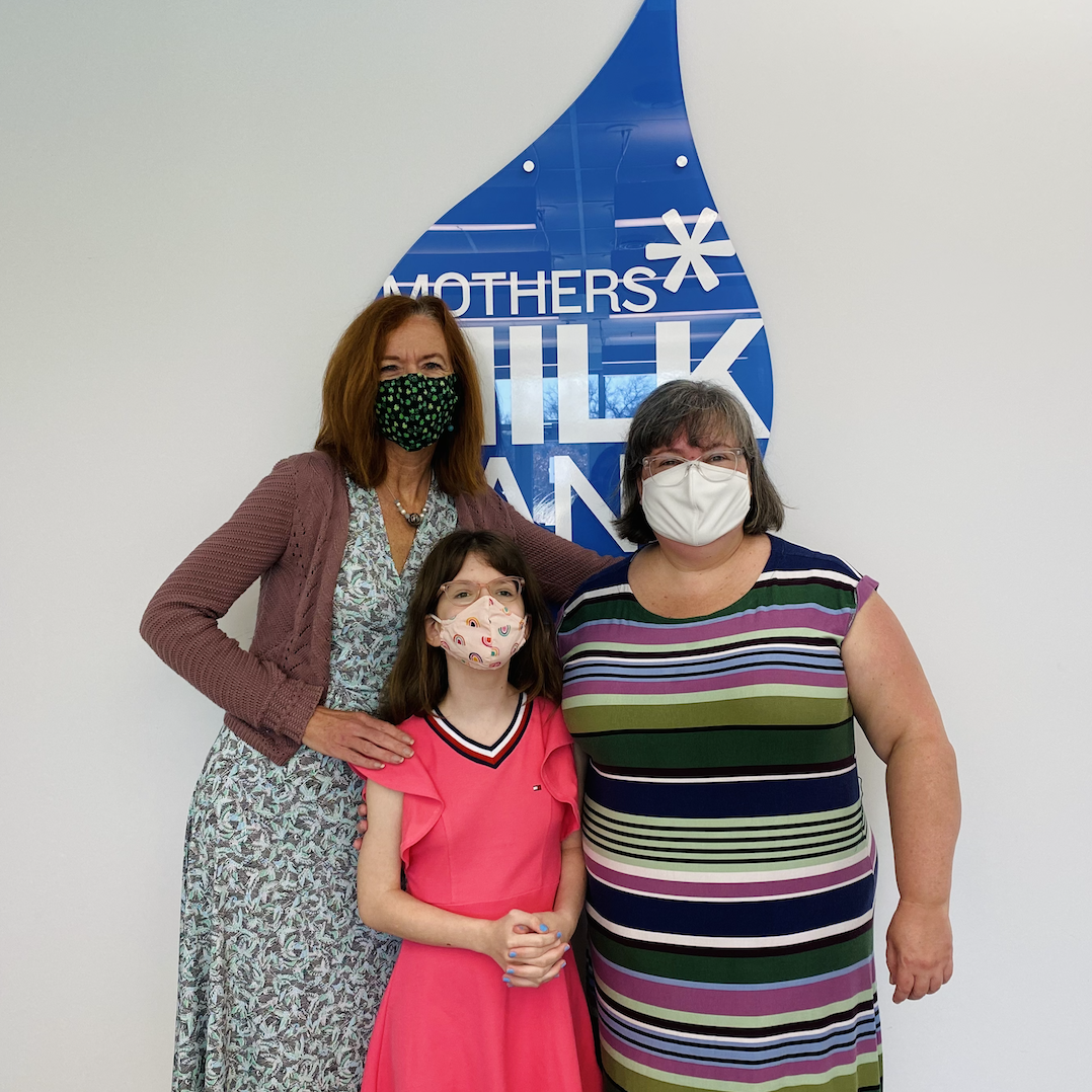 people posing for a photo at mothers milk bank